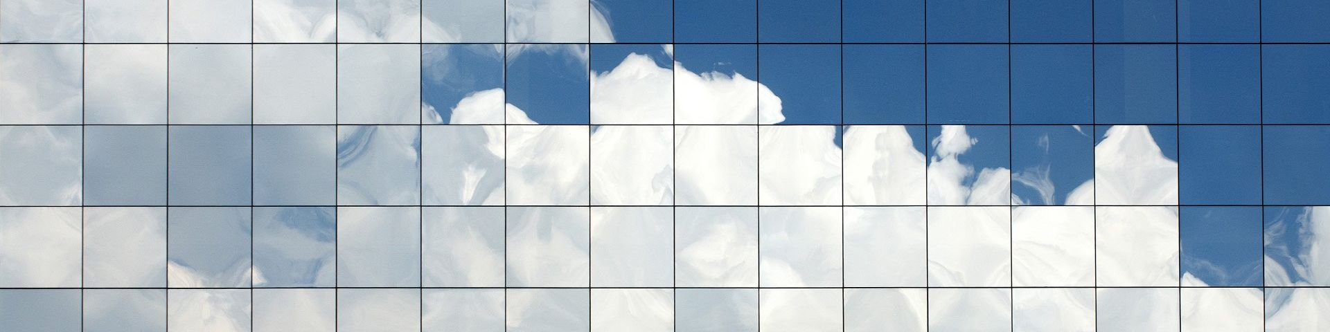 Clouds reflected in glass windows.